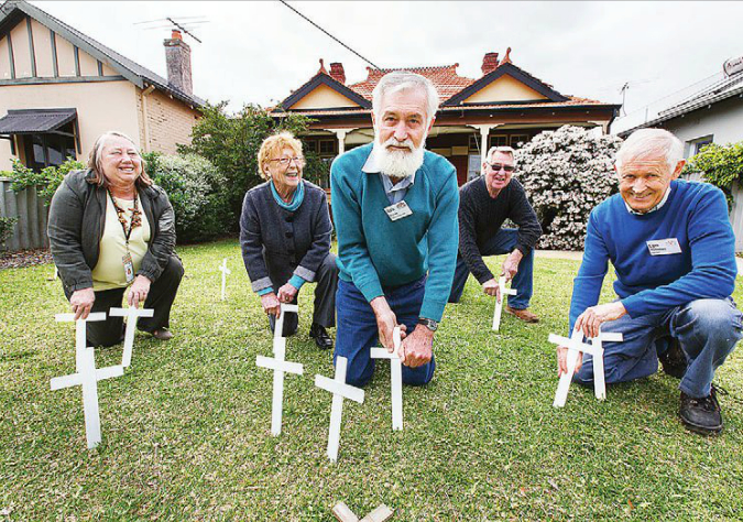 Photo of Shed members outside ANZAC Cottage.