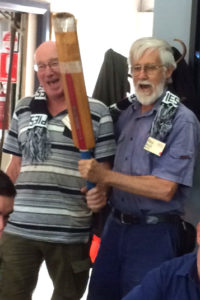 Photo of Bruce and Roy celebrating their 100th attendance.